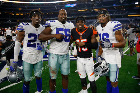 Dallas Cowboys safety Tyree Robinson (23), defensive end Datone Jones (56), and wide receiver Darren Carrington (16) pose for a photo with Cincinnati Bengals wide receiver John Ross (15) after a preseason NFL Football game in Arlington, Texas