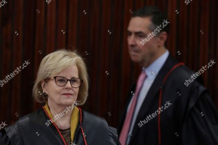 Rosa Weber, Luis Roberto Barroso. Brazil's President of the Superior Electoral Court Rosa Weber, left, and Minister Luis Roberto Barroso arrive to attend the trial against the candidacy of jailed former president da Luis Inacio Lula da Silva, in Brasilia, Brazil, . Brazil's general elections will be held on October 7