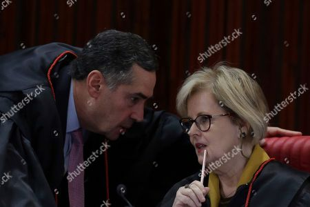 Stock Picture of Rosa Weber, Luís Roberto Barroso. Brazil's President of the Superior Electoral Court Rosa Weber, right, talks with Minister Luís Roberto Barroso during a the trial against the candidacy of jailed former president da Luis Inacio Lula da Silva, in Brasilia, Brazil, . Brazil's general elections will be held on October 7