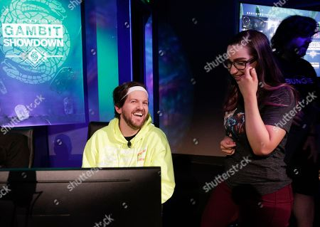 DJ Dillon Francis, left, competes during the Destiny 2: Forsaken Gambit Showdown at Bungie headquarters on in Bellevue, Wash