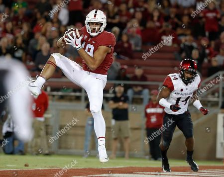 Stanford wide receiver JJ Arcega-Whiteside (19) catches a touchdown pass against San Diego State safety Tariq Thompson (14) during the second half of an NCAA college football game, in Stanford, Calif