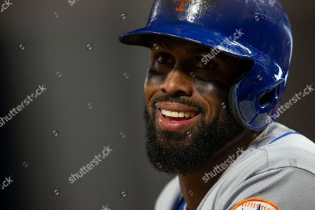 New York Mets shortstop Jose Reyes watches from the dugout during the fifth inning of the team's baseball game against the San Francisco Giants, in San Francisco