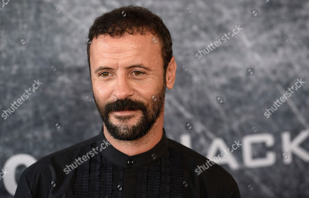 "Ali Suliman, a cast member in ""Tom Clancy's Jack Ryan,"" poses at the premiere of the Amazon Prime Video television series at the Port of Los Angeles, in Los Angeles"