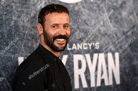 "Stock Image of Ali Suliman, a cast member in ""Tom Clancy's Jack Ryan,"" poses at the premiere of the Amazon Prime Video television series at the Port of Los Angeles, in Los Angeles"