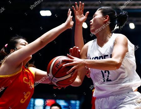 Suk Yong Ro (L) of Unified inter-Korea in action against Meng Li (R) of China during the Women's Basketball 5x5 Gold Medal Game between China and unified team from the Democratic People's Republic of Korea (DPRK) and the Republic of Korea (ROK) at the Asian Games 2018 in Jakarta, Indonesia, 01 September 2018.