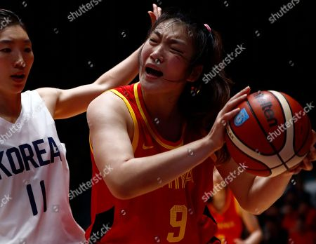 Meng Li (R) of China in action during the Women's Basketball 5x5 Gold Medal Game between China and unified team from the Democratic People's Republic of Korea (DPRK) and the Republic of Korea (ROK) at the Asian Games 2018 in Jakarta, Indonesia, 01 September 2018.