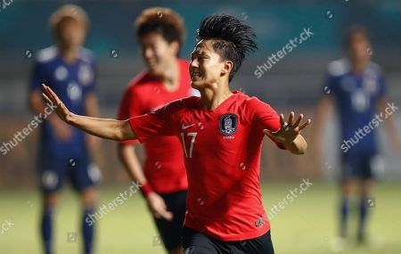 South Korea's Lee Seung-woo celebrates after scoring against Japan during the soccer men's gold medal match at the 18th Asian Games in Bogor, Indonesia