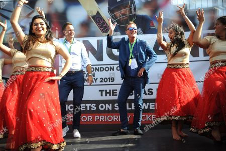 Stock Picture of Ex England player and now BBC TMS commentators Phil Tufnell (right) and Michael Vaughn (Left) take part in a Bollywood dance Routine with Southampton University Indian Dance Society during the third day of the 4th SpecSavers International Test Match 2018 match between England and India at the Ageas Bowl, Southampton