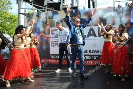 Ex England player and now BBC TMS commentators Phil Tufnell (right) and Michael Vaughn (Left) take part in a Bollywood dance Routine with Southampton University Indian Dance Society during the third day of the 4th SpecSavers International Test Match 2018 match between England and India at the Ageas Bowl, Southampton
