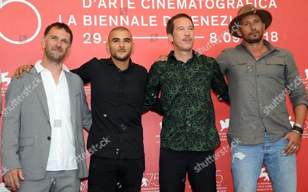 (L-R)French director David Oelhoffen, French actor Sofiane Zermani, French actor Reda Kateb and Belgian actor Matthias Schoenaerts pose during a photocall for 'Freres Ennemis' during the 75th annual Venice International Film Festival, in Venice, Italy, 01 September 2018. The movie is presented in the official competition 'Venezia 75' at the festival running from 29 August to 08 September 2018.