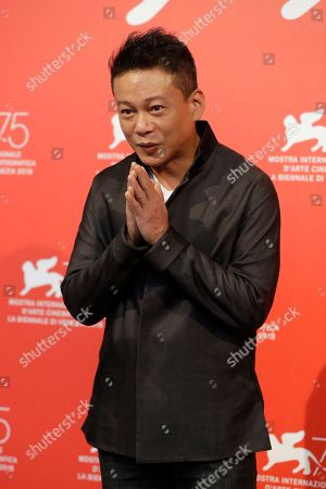 Stock Picture of Actor Lee Kang-sheng poses for photographers at the photo call for the film 'Your Face' at the 75th edition of the Venice Film Festival in Venice