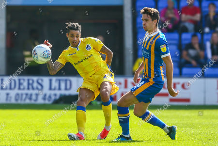 Daniel Leadbitter of Bristol Rovers is challenged by Alex Gilliead of Shrewsbury Town