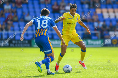 Daniel Leadbitter of Bristol Rovers is marked by Alex Gilliead of Shrewsbury Town ,- Mandatory by-line: Ryan Hiscott/JMP