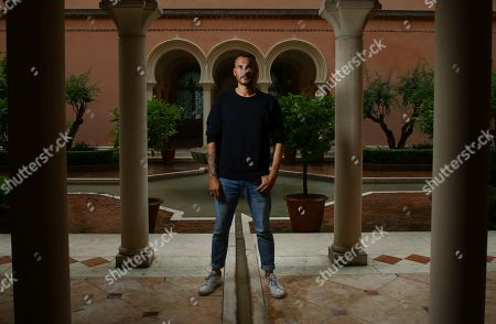 Sebastien Marnier poses for portrait photographs for the film 'School's Out' at the 75th edition of the Venice Film Festival in Venice, Italy