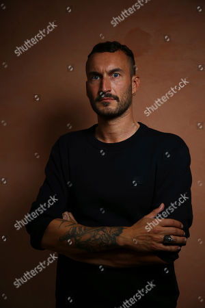 Stock Image of Sebastien Marnier poses for portrait photographs for the film 'School's Out' at the 75th edition of the Venice Film Festival in Venice, Italy