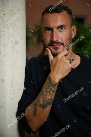 Stock Picture of Sebastien Marnier poses for portrait photographs for the film 'School's Out' at the 75th edition of the Venice Film Festival in Venice, Italy