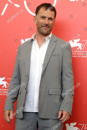 Director David Oelhoffen poses for photographers at the photo call for the film 'Close Enemies' at the 75th edition of the Venice Film Festival in Venice, Italy
