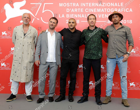 Producer Marc du Pontavice, left, director David Oelhoffen, second left, actors Sofiane Zermani, centre, Reda Kateb, second right, and Matthias Schoenaerts, right, pose for photographers at the photo call for the film 'Close Enemies' at the 75th edition of the Venice Film Festival in Venice, Italy