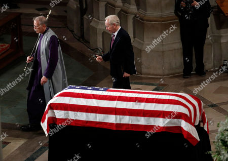 Stock Photo of Former Sen. Joseph Lieberman finishes speaking at a memorial service for Sen. John McCain, R-Ariz., at Washington National Cathedral in Washington, . McCain died Aug. 25, from brain cancer at age 81