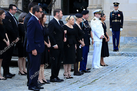 The family of Sen. John McCain, R-Ariz., from left, Doug McCain, Andrew McCain (partially hidden), Sidney McCain, Ben Domenech and his wife Meghan McCain, Cindy McCain, Jimmy McCain and his wife Holly and Jack McCain and his wife Renee Swift watch as the casket of Sen. John McCain, R-Ariz., arrives at the Washington National Cathedral in Washington, for a memorial service. McCain died Aug. 25 from brain cancer at age 81