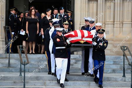 Cindy McCain, center, widow of Sen. John McCain, R-Ariz., escorted by her son Jimmy McCain and other family members, follows his casket as it is carried out of Washington National Cathedral in Washington, following a memorial service. McCain died Aug. 25 from brain cancer at age 81