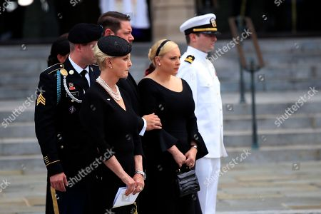The family of Sen. John McCain, R-Ariz., from left, Jimmy McCain, Cindy McCain, Ben Domenech and his wife Meghan McCain, and Jack McCain watch as the casket is placed into the hearse following a memorial service at the Washington National Cathedral in Washington