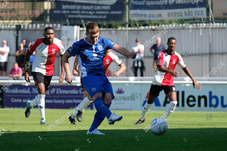 Stock Image of Jake Robinson of Billericay Town scores the first goal for his team from the penalty spot during Woking vs Billericay Town, Vanarama National League South Football at The Laithwaite Community Stadium on 1st September 2018