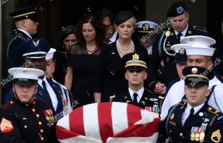 John McCain, Cindy McCain. Cindy McCain, center, widow of Sen. John McCain, R-Ariz., escorted by Jimmy McCain and other family members, follow his casket as it is carried out of Washington National Cathedral in Washington, following a memorial service. McCain died Aug. 25 from brain cancer at age 81
