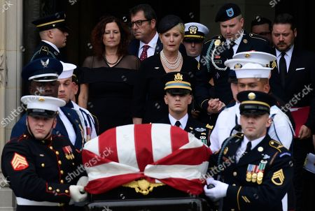 John McCain, Cindy McCain. Cindy McCain, center, widow of Sen. John McCain, R-Ariz., escorted by her son Jimmy McCain and other family members, follows his casket as it is carried out of Washington National Cathedral in Washington, following a memorial service. McCain died Aug. 25 from brain cancer at age 81
