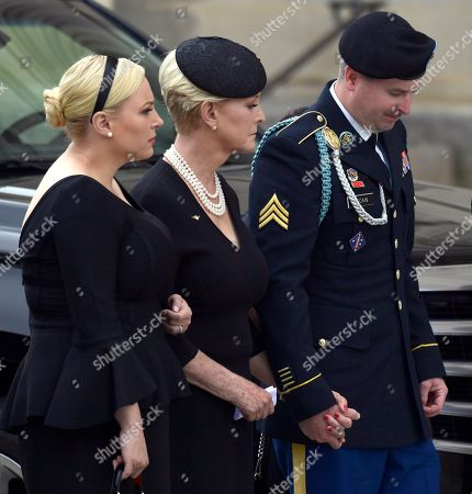 John McCain, Cindy McCain, James McCain, Meghan McCain. Cindy McCain, center, flanked by her children Meghan McCain, left, and Jimmy McCain, right, watch as the casket of Sen. John McCain, R-Ariz., arrives at the Washington National Cathedral in Washington, for a memorial service. McCain died Aug. 25 from brain cancer at age 81
