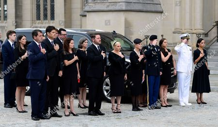 John McCain, Cindy McCain. The family of Sen. John McCain, R-Ariz., from left, Doug McCain, Andrew McCain, Sidney McCain, Ben Domenech and his wife Meghan McCain, Cindy McCain, Jimmy McCain and his wife Holly and Jack McCain and his wife Renee Swift watch as the casket of Sen. John McCain, R-Ariz., arrives at the Washington National Cathedral in Washington, for a memorial service. McCain died Aug. 25 from brain cancer at age 81