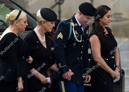 From left, Meghan McCain, Cindy McCain, Jimmy McCain and his wife Holly arrive at a memorial service for Sen. John McCain, R-Ariz., at the Washington National Cathedral in Washington, . McCain died Aug. 25 from brain cancer at age 81