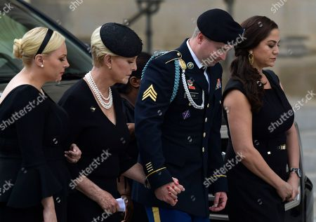 John McCain, Cindy McCain, James McCain, Meghan McCain. From left, Meghan McCain, Cindy McCain, Jimmy McCain and his wife Holly pause as they watch the casket of Sen. John McCain, R-Ariz., arrive at the Washington National Cathedral in Washington, for a memorial service. McCain died Aug. 25 from brain cancer at age 81