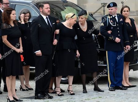 John McCain, Cindy McCain, Meghan McCain. The family of Sen. John McCain, R-Ariz., from left, Sidney McCain, Ben Domenech and his wife Meghan McCain, Cindy McCain, Jimmy McCain and his wife Holly and Jack McCain and his wife Renee Swift watch as the casket of Sen. John McCain, R-Ariz., arrives at the Washington National Cathedral in Washington, for a memorial service. McCain died Aug. 25 from brain cancer at age 81