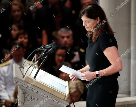 Former New Hampshire Sen. Kelly Ayotte reads scripture at a memorial service for Sen. John McCain, R-Ariz., at Washington National Cathedral in Washington, . McCain died Aug. 25, from brain cancer at age 81
