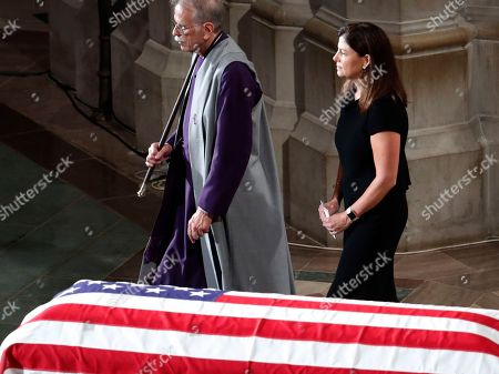 Stock Picture of Former New Hampshire Sen. Kelly Ayotte walks after reading scripture at a memorial service for Sen. John McCain, R-Ariz., at Washington National Cathedral in Washington, . McCain died Aug. 25, from brain cancer at age 81