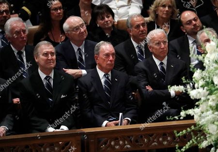 Front from left, former Defense Secretary William Cohen, former New York Mayor Michael Bloomberg and former Vice President Joe Biden listen during a memorial service for Sen. John McCain, R-Ariz., at Washington National Cathedral in Washington, . McCain died Aug. 25, from brain cancer at age 81. Back row, second from right is former Texas Senator Phil Gramm and third from left is former Wisconsin Sen. Russ Feingold
