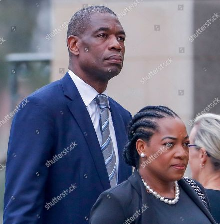 Former professional basketball player Dikembe Mutombo (L) of the Democratic Republic of Congo and his wife Rose Mutombo (R) arrive for the funeral service for Senator John McCain at the Washington National Cathedral in Washington, DC, USA, 01 September 2018. McCain died 25 August, 2018 from brain cancer at his ranch in Sedona, Arizona, USA. He was a veteran of the Vietnam War, served two terms in the US House of Representatives, and was elected to five terms in the US Senate. McCain also ran for president twice, and was the Republican nominee in 2008.