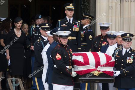 Widow of John McCain, Cindy McCain (L) and son James McCain (2-L) and family members follow a US military honor guard team carrying the flag-draped casket of John McCain out of the Washington National Cathedral at the end of a memorial service in Washington, DC, USA, 01 September 2018. Senator McCain died 25 August, 2018 from brain cancer at his ranch in Sedona, Arizona, USA. He was a veteran of the Vietnam War, served two terms in the US House of Representatives, and was elected to five terms in the US Senate. McCain also ran for president twice, and was the Republican nominee in 2008.