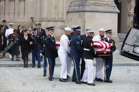 Widow of John McCain, Cindy McCain (C-L) and son James McCain (2-L) and family members follow a US military honor guard team carrying the flag-draped casket of John McCain out of the Washington National Cathedral at the end of a memorial service in Washington, DC, USA, 01 September 2018. Senator McCain died 25 August, 2018 from brain cancer at his ranch in Sedona, Arizona, USA. He was a veteran of the Vietnam War, served two terms in the US House of Representatives, and was elected to five terms in the US Senate. McCain also ran for president twice, and was the Republican nominee in 2008.