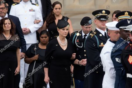Widow of John McCain, Cindy McCain (C-L) and son James McCain (C-R) and family members follow a US military honor guard team carrying the flag-draped casket of John McCain out of the Washington National Cathedral at the end of a memorial service in Washington, DC, USA, 01 September 2018. Senator McCain died 25 August, 2018 from brain cancer at his ranch in Sedona, Arizona, USA. He was a veteran of the Vietnam War, served two terms in the US House of Representatives, and was elected to five terms in the US Senate. McCain also ran for president twice, and was the Republican nominee in 2008.