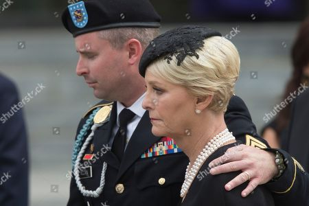 Widow of John McCain, Cindy McCain (R) and son James McCain (L) depart after a memorial service for John McCain at the Washington National Cathedral in Washington, DC, USA, 01 September 2018. Senator McCain died 25 August, 2018 from brain cancer at his ranch in Sedona, Arizona, USA. He was a veteran of the Vietnam War, served two terms in the US House of Representatives, and was elected to five terms in the US Senate. McCain also ran for president twice, and was the Republican nominee in 2008.
