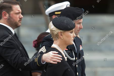 Widow of John McCain, Cindy McCain (C) and son James McCain (R) and family members watch a US military honor guard team carry the flag-draped casket of John McCain out of the Washington National Cathedral at the end of a memorial service in Washington, DC, USA, 01 September 2018. Senator McCain died 25 August, 2018 from brain cancer at his ranch in Sedona, Arizona, USA. He was a veteran of the Vietnam War, served two terms in the US House of Representatives, and was elected to five terms in the US Senate. McCain also ran for president twice, and was the Republican nominee in 2008.