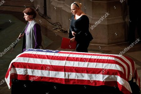 Meghan McCain walks by the casket of her father Senator John McCain during a memorial service at the Washington National Cathedral in Washington, DC, USA, 01 September 2018. Senator McCain died 25 August, 2018 from brain cancer at his ranch in Sedona, Arizona, USA. He was a veteran of the Vietnam War, served two terms in the US House of Representatives, and was elected to five terms in the US Senate. McCain also ran for president twice, and was the Republican nominee in 2008.