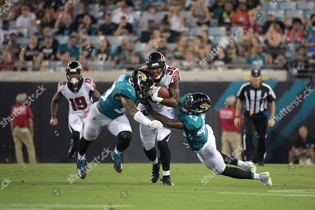 Atlanta Falcons running back Malik Williams (35) is tackled by Jacksonville Jaguars defensive back Quenton Meeks (43) and linebacker Blair Brown (53) after rushing for yardage during the second half of an NFL preseason football game, in Jacksonville, Fla. The Jaguars won 17-6