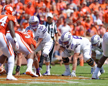 Stock Photo of Furman quarterback Harris Roberts (15) gets set to takes the snap with blocking help from Jacob Conrad (68) during the first half of an NCAA college football game against Clemson, in Clemson, S.C