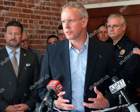 Paul Davis, the Democratic nominee in the 2nd Congressional District of eastern Kansas, answers questions during a news conference with representatives and public safety groups that have endorsed him, in Topeka, Kan. Davis has distanced himself from House Democratic Leader Nancy Pelosi but Republicans are nonetheless trying to tie him to her