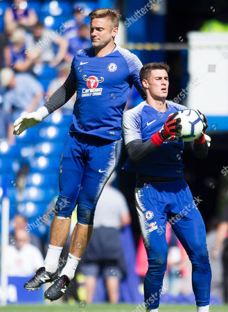 Kepa Arrizabalaga and Robert Green warm up before the game