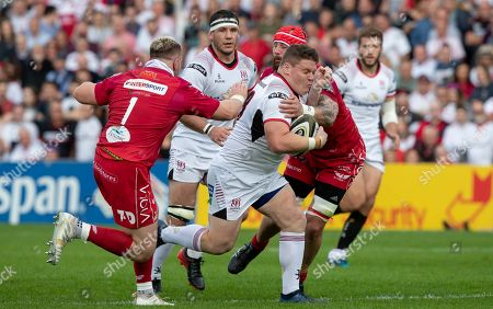 Ulster vs Scarlets. Ulster's Ross Kane with Blade Thomson and Rob Evans of Scarlets