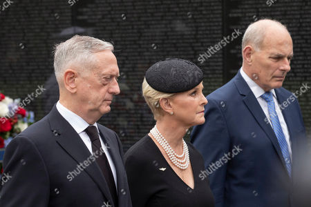 Cindy McCain, the wife of Sen. John McCain, R-Ariz., with Defense Secretary James Mattis, left, and White House Chief of Staff John Kelly, walks at the Vietnam Veterans Memorial in Washington
